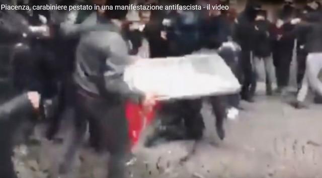 Il fotogramma dell'aggressione al Carabiniere (fotogramma video zonedombratv.it)